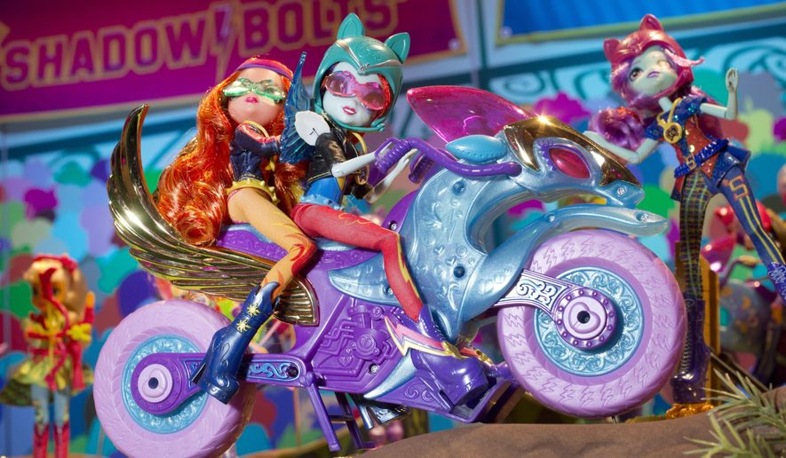 FILE - In this Feb. 14, 2014, file photo the My Little Pony Equestria Girls Friendship Games Motocross Bike ridden by Sunset Shimmer, left, and Rainbow Dash is displayed at the Hasbro showroom at the North American International Toy Fair in New York. From G.I. Joe to My Little Pony, toymaker Hasbro says it is holding the first-ever convention bringing all its brands together in Providence, R.I., in September of 2017. (AP Photo/Mark Lennihan, File)