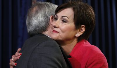 Iowa Gov. Terry Branstad gets a hug from Lt. Gov. Kim Reynolds, right, during his weekly news conference, Tuesday, May 23, 2017, at the Statehouse in Des Moines, Iowa. Branstad was confirmed on Monday, May 22, 2017, as the next U.S. ambassador to China. Reynolds will be sworn in as Iowa Governor during a ceremony on Wednesday after Branstad resigns. (AP Photo/Charlie Neibergall)