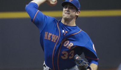 In this Friday, May 12, 2017, photo, New York Mets starting pitcher Matt Harvey throws during the first inning of a baseball game against the Milwaukee Brewers in Milwaukee. It will be interesting to see how Harvey is received by Mets fans when the embattled pitcher makes his first start at Citi Field since serving a three-day suspension for skipping a game this month following a late night on the town. (AP Photo/Morry Gash)