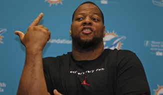 Miami Dolphins defensive tackle Ndamukong Suh gestures as he speaks during a news conference after NFL football practice, Tuesday, May 23, 2017, at the Dolphins training facility in Davie, Fla. (AP Photo/Wilfredo Lee)