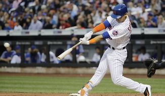 New York Mets' Michael Conforto (30) hits a two-run single during the first inning of a baseball game against the San Diego Padres Tuesday, May 23, 2017, in New York. (AP Photo/Frank Franklin II)
