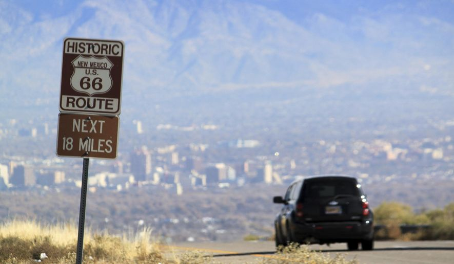 In this Nov. 19, 2014, file photo, a car travels down historic Route 66 toward Albuquerque, N.M. Route 66, the historic American roadway that linked Chicago to the West Coast. (AP Photo/Susan Montoya Bryan, file)