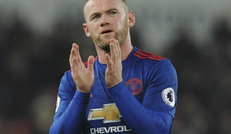 FILE - In this Jan. 21, 2017 file photo, Manchester United's Wayne Rooney acknowledges the fans after the English Premier League soccer match between Stoke City and Manchester United at the Britannia Stadium, Stoke on Trent, England.  Manchester United will play Ajax in the  Europa League final in Stockholm on Wednesday May 24, 2017. (AP Photo/Rui Vieira, File)