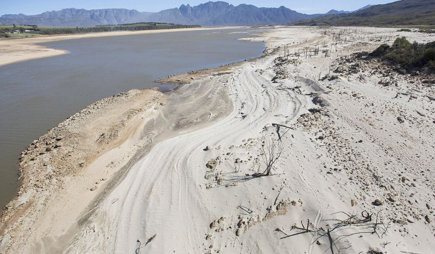 In this photo taken Sunday, April 16, 2017, the Theewaterskloof Dam, a key source of water supply to Cape Town, South Africa, is shown at low levels. The city, a major international tourist attraction, is instructing people to severely restrict water use because of the area's worst drought in more than a century. (AP Photo/Halden Krog)