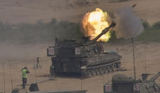 In this Monday, May 22, 2017 photo, South Korean army's K-55 self-propelled howitzer fires during the annual exercise in Paju, near the border with North Korea, South Korea. South Korea's military said Tuesday, May 23, 2017, it fired warning shots at an unidentified object flying south from rival North Korea. (Lim Byung-shick/Yonhap via AP)