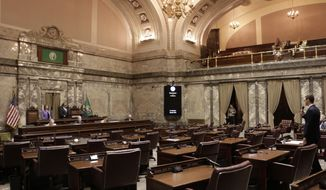 Republican Sen. Joe Fain, far right of frame, speaks in a mostly empty Senate chamber during adjournment of a 30-day special legislative session, on Tuesday, May 23, 2017, in Olympia, Wash. Gov. Jay Inslee immediately called the Legislature back for a second overtime session so that lawmakers can complete their work on the state budget. (AP Photo/Rachel La Corte)