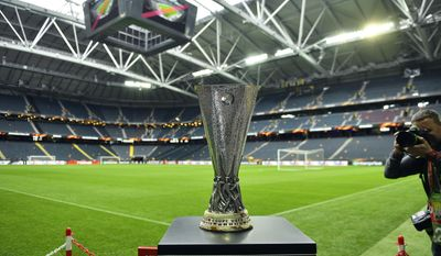 The Europa League trophy is on display on the pitch at the Friends Arena in Stockholm, Sweden, Tuesday, May 23, 2017. Ajax Amsterdam and Manchester United will play the soccer Europa League final in Stockholm on Wednesday, May 24. (AP Photo/Martin Meissner)