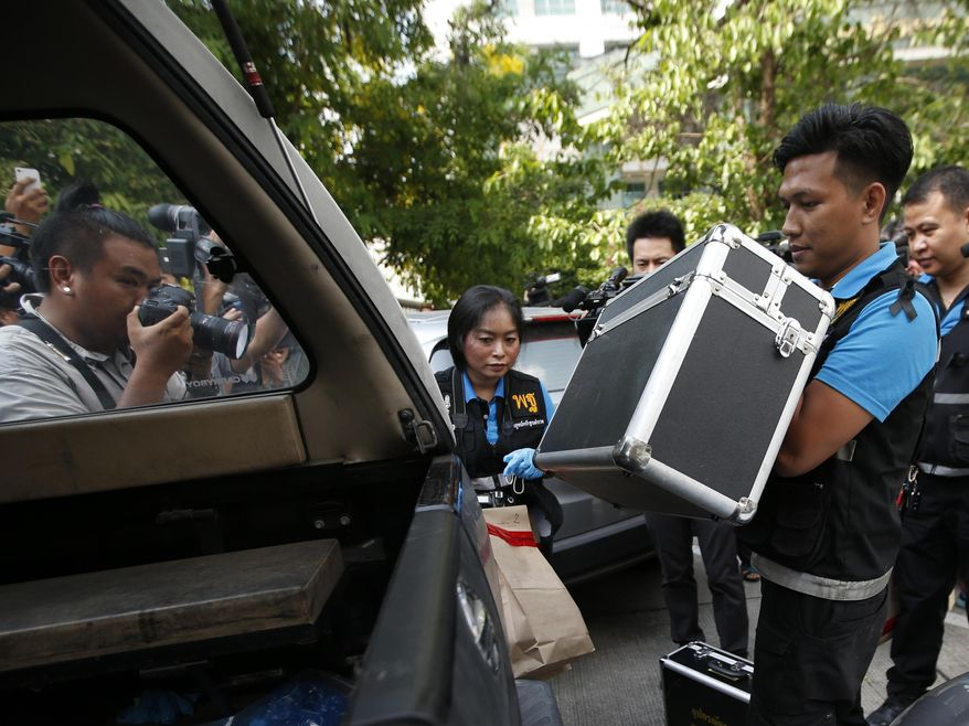 Thai forensic collect evidence at Phramongkutklao Hospital, a military-owned hospital that is also open to civilians, in Bangkok after a bomb wounded more than 20 people, in Bangkok Monday, May 22, 2017.  A bomb exploded at a military-run hospital in Bangkok on Monday, the third anniversary of a military coup. (AP Photo/Sakchai Lalit)