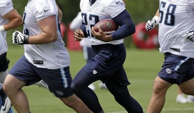 Tennessee Titans running back Derrick Henry (22) runs a drill during the team's organized team activity at its NFL football training facility Tuesday, May 23, 2017, in Nashville, Tenn. (AP Photo/Mark Humphrey)