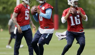Tennessee Titans quarterbacks Marcus Mariota (8), Matt Cassel (16) and Tyler Ferguson (5) run a drill during the team's organized team activity at its NFL football training facility Tuesday, May 23, 2017, in Nashville, Tenn. (AP Photo/Mark Humphrey)