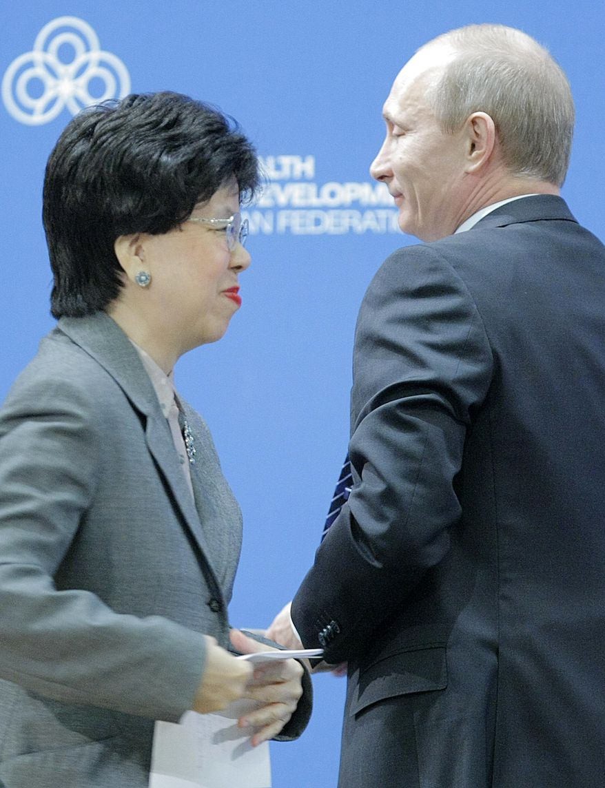 FILE- In this Thursday, April 28, 2011 file photo, Russian Prime Minister Vladimir Putin right, jokes with WHO Director General Dr Margaret Chan during the World Health Organization meeting on healthy lifestyle in Moscow. After leading the World Health Organization for the last decade, Dr. Margaret Chan knows all too well how politics infuses actions at nearly every level of the U.N. agency. As WHO member countries prepare to elect her successor on Tuesday, May 23, 2017 the Associated Press reveals eyebrow-raising details from internal documents that show how she appeased dictators in Turkmenistan and North Korea - and told then-Prime Minister Vladimir Putin she'd see to how WHO might hire more Russians.(AP Photo/Mikhail Metzel, File )