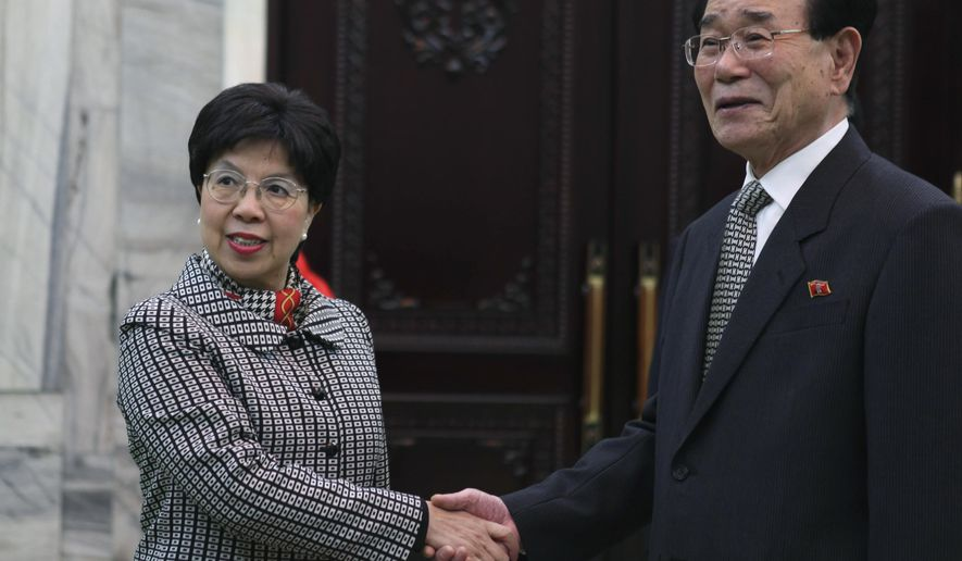FILE - In this Wednesday April 28, 2010 file photo, United Nations World Heath Organization Director-General Margaret Chan, left, shakes hands with North Korea's No. 2 leader Kim Yong Nam, before sitting down for a formal meeting in Pyongyang. After leading the World Health Organization for the last decade, Dr. Margaret Chan knows all too well how politics infuses actions at nearly every level of the U.N. agency. As WHO member countries prepare to elect her successor on Tuesday, May 23, 2017 the Associated Press reveals eyebrow-raising details from internal documents that show how she appeased dictators in Turkmenistan and North Korea - and told then-Prime Minister Vladimir Putin she'd see to how WHO might hire more Russians. (AP Photo, file)