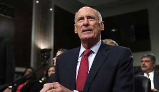 Director of National Intelligence Dan Coats prepares to testify on Capitol Hill in Washington, Tuesday, May 23, 2017, before the Senate Armed Services Committee hearing on worldwide threats. (AP Photo/Jacquelyn Martin)
