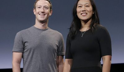 FILE- In this Sept. 20, 2016, file photo, Facebook CEO Mark Zuckerberg and his wife, Priscilla Chan, smile as they prepare for a speech in San Francisco. The 33-year-old billionaire and his wife stopped by Quincy High School on Tuesday, May 23, 2017, and made a donation to the school. Chan graduated from Quincy High as valedictorian in 2003. (AP Photo/Jeff Chiu, File)