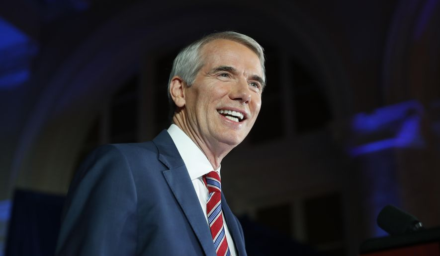 FILE - In this Nov. 8, 2016 file photo, Sen. Rob Portman, R-Ohio, smiles as he speaks during an election night rally at The Vault, in Columbus, Ohio. Ohio's moderate Republican senator, Portman, is throwing his support behind Ohio Treasurer Josh Mandel for U.S. Senate. In a video posted early Wednesday, May 24, 2017, Portman urges Republicans in the battleground state to unify behind Mandel as he seeks to unseat Democratic incumbent Sherrod Brown. (AP Photo/John Minchillo, File)