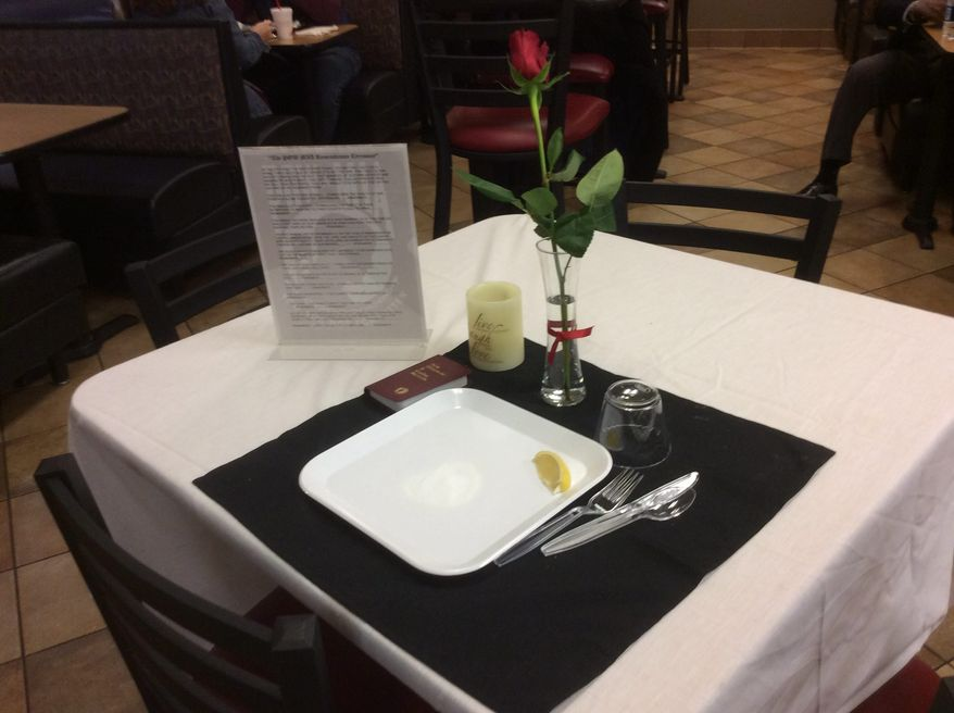 Select D.C.-area Chick-fil-A restaurants set up Missing Man Tables, like this one at the Bristow Chick-fil-A in Manassas, Virginia, for its market-wide Military Appreciation Day on Wednesday, May 25, to honor those who have made the ultimate sacrifice. Image courtesy of Chick-fil-A.