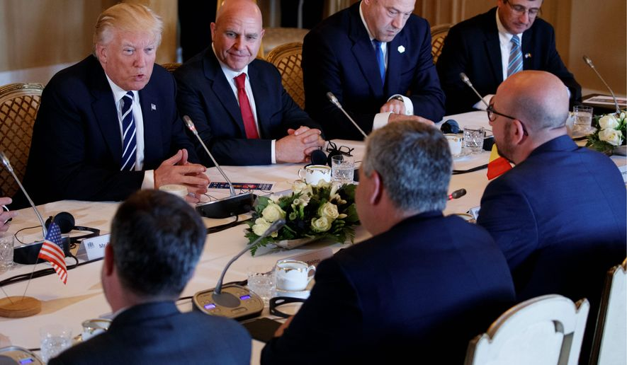 President Trump meets with Belgian Prime Minister Charles Michel, right, at the Royal Palace on Wednesday in Brussels. The surge in Taliban violence and attacks by the Islamic State in Afghanistan will be Mr. Trump's focus when he visits NATO headquarters. (Associated Press)