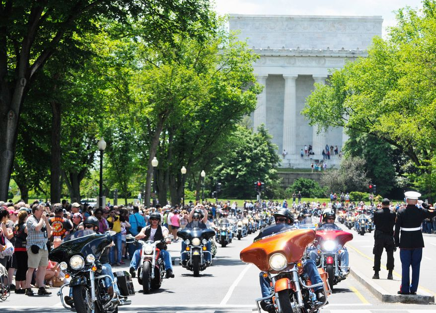 Motorcyclists from across the country shook the ground during the Rolling Thunder in the 25th anniversary of the Rolling Thunder Ride for Freedom at the base of the Memorial Bridge. Khalid Naji-Allah/ Special for the Washington Times.
