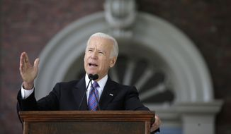 Former Vice President Joe Biden delivers the annual Harvard College Class Day address, Wednesday, May 24, 2017, on the campus of Harvard University, in Cambridge, Mass. (AP Photo/Steven Senne) ** FILE **