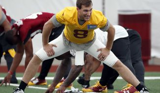 Washington Redskins quarterback Kirk Cousins (8) stretches during practice at the team's NFL football training facility at Redskins Park, Wednesday, May 24, 2017, in Ashburn, Va. (AP Photo/Alex Brandon)