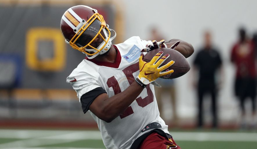 Washington Redskins wide receiver Ryan Grant runs with the ball during practice at the team's NFL football training facility at Redskins Park, Wednesday, May 24, 2017 in Ashburn, Va. (AP Photo/Alex Brandon)