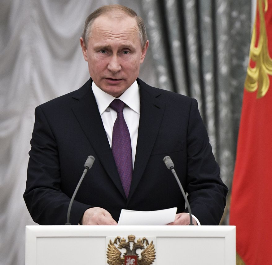 Russian President Vladimir Putin speaks at a state award ceremony in the Kremlin in Moscow, Russia, Wednesday, May 24, 2017. Russian scientists, culture and sports figures were presented with state awards by Russian President Vladimir Putin on Wednesday. (Alexei Nikolsky/Pool Photo via AP) ** FILE **