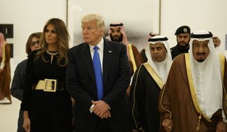 FILE - In this May 20, 2017 file photo, President Donald Trump and first lady Melania Trump visit an art exhibit with Saudi King Salam at the Royal Court Palace in Riyadh. (AP Photo/Evan Vucci, File)