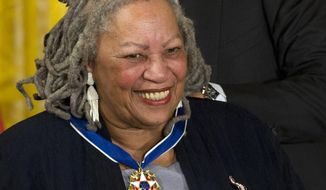 FILE - In this May 29, 2012 file photo, author Toni Morrison receives her Medal of Freedom award during a ceremony in the East Room of the White House in Washington. Nobel literature laureate Morrison and James Patterson received Distinguished Service Awards at the Authors Guild's 25th annual gala in New York City on Wednesday, May 24, 2017. (AP Photo/Carolyn Kaster, File)