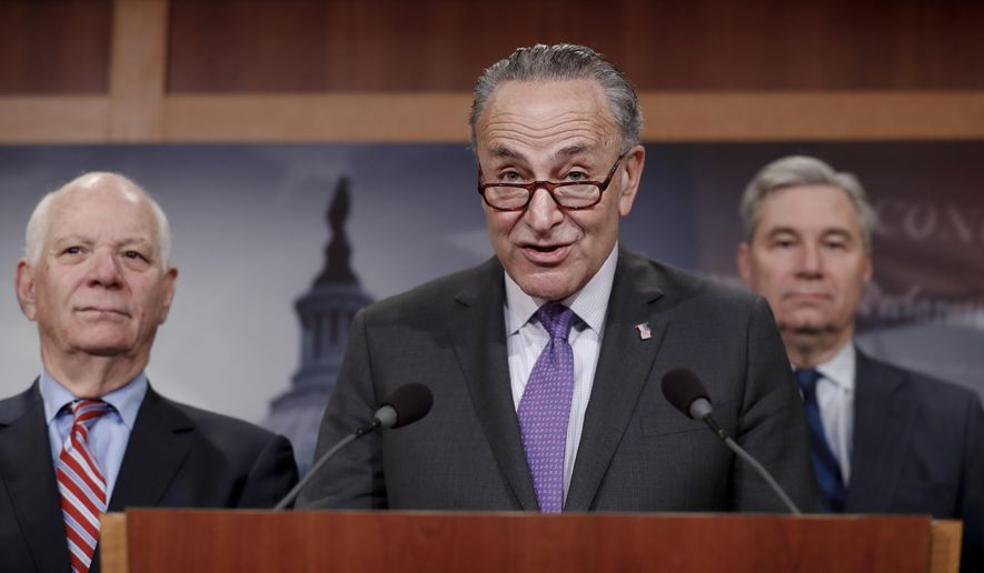 Senate Minority Leader Charles Schumer of N.Y., joined by Sen. Sheldon Whitehouse, D-R.I., right, and Sen. Ben Cardin, D-Md., left, speaks during a news conference about the Paris climate agreement, Wednesday, May 24, 2017, on Capitol Hill in Washington. (AP Photo/Carolyn Kaster) **FILE**