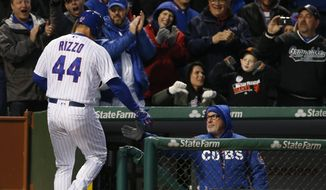 Chicago Cubs' Anthony Rizzo, left, celebrates with manager Joe Maddon after hitting a solo home run in the fourth inning of a baseball game against the San Francisco Giants, Wednesday, May 24, 2017, in Chicago. (AP Photo/Nam Y. Huh)
