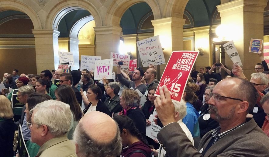 Protesters from labor and other progressive groups fill the rotunda of the state Capitol in St. Paul, Minn., on Wednesday, May 24, 2017, to demand that Democratic Gov. Mark Dayton veto the bills that passed before the Minnesota Legislature's special session bogged down earlier in the day. (AP Photo/Steve Karnowski)