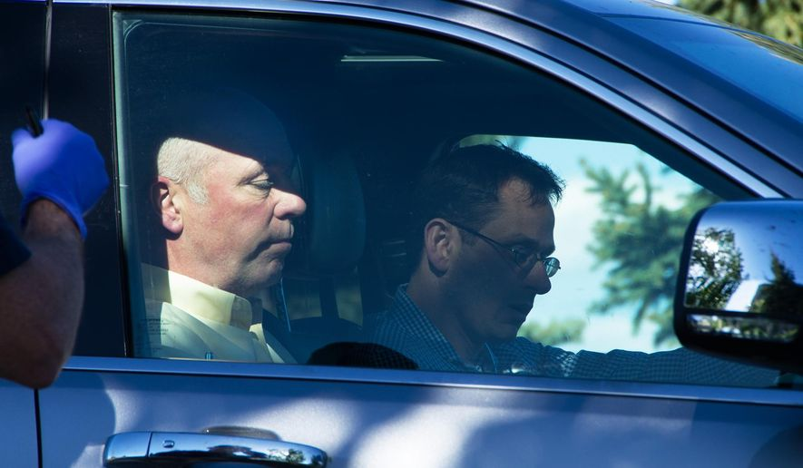 "Republican candidate for Montana's only U.S. House seat, Greg Gianforte, sits in a vehicle near a Discovery Drive building Wednesday, May 24, 2017, in Bozeman, Mont. A reporter said Gianforte ""body-slammed"" him Wednesday, the day before the special election. (Freddy Monares/Bozeman Daily Chronicle via AP)"