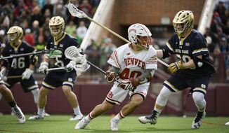 In this Sunday, March 12, 2017 photo, Denver attacker Connor Cannizzaro moves the ball during the second quarter of an NCAA college lacrosse game against Notre Dame in Denver. Cannizzaro will lead his teammates against top-seeded Maryland on Saturday, May 27, 2017, in the semifinals of the NCAA Division 1 men's lacrosse tournament in Foxborough, Mass. (Helen H. Richardson/The Denver Post via AP)