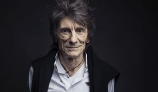 FILE - In this Nov. 14, 2016 file photo, Ronnie Wood of the Rolling Stones poses for a portrait in New York. A spokesperson for Ronnie Wood confirmed Wednesday, May 24, 2017, that during a recent routine medical screening, doctors discovered a small lung lesion which was successfully treated. The band's upcoming tour will not be affected. (Photo by Victoria Will/Invision/AP, File)