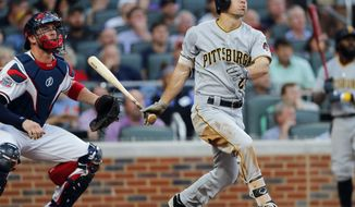 Pittsburgh Pirates' Adam Frazier (26) watches the flight of a three-run home run as Atlanta Braves catcher Tyler Flowers (25) looks on in the second inning of a baseball game Wednesday, May 24, 2017, in Atlanta. (AP Photo/John Bazemore)
