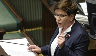 """Polish Prime Minister Beata Szydlo speaks in the Polish parliament during a debate on a vote to dismiss Defense Minister Antoni Macierewicz, in Warsaw, Poland, Wednesday, May 24, 2017. Szydlo said that Poland cannot be blackmailed by """"Brussels elites"""" to accept migrants. (AP Photo/Alik Keplicz)"""