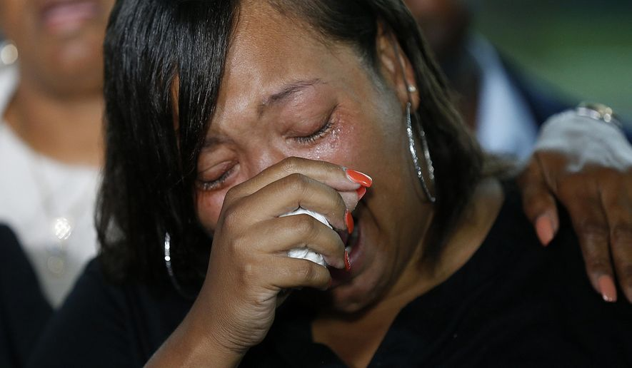 FILE - In this Wednesday, May 3, 2017, file photo, Kimberly Pierson, mother of Alton Sterling's son Na'Quincy Pierson, cries as she speaks to reporters following a meeting with the U.S. Justice Department at federal court in Baton Rouge, La. The family of Alton Sterling is demanding the immediate firing of the two officers involved in the man's death. (AP Photo/Gerald Herbert, File)