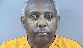 This is a Madison County Detention Center booking photograph taken May 17, 2017, in Canton, Miss., of former state corrections commissioner Chris Epps, who pleaded guilty in 2015 to money laundering and filing false tax returns in connection with nearly $1.5 million in bribes he took from contractors doing business with Mississippi prisons. He has been jailed for violating terms of his bond. Federal prosecutors are recommending that Epps spend 13 years in prison, although U.S. District Judge Henry T. Wingate has warned both parties that he might give a heavier sentence. (Madison County Detention Center, via AP)