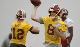Washington Redskins quarterback Kirk Cousins (8) throws the ball during practice at the team's NFL football training facility at Redskins Park, Wednesday, May 24, 2017 in Ashburn, Va. (AP Photo/Alex Brandon)