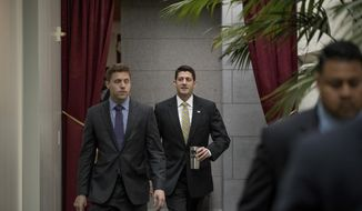 House Speaker Paul Ryan of Wis., center, arrives for a GOP caucus meeting on Capitol Hill in Washington, Tuesday, May 23, 2017. (AP Photo/Andrew Harnik)