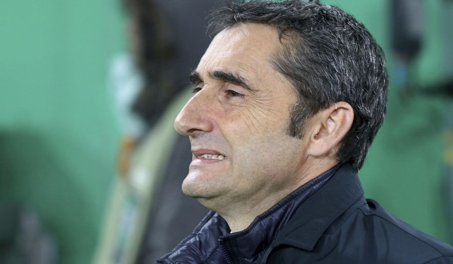 FILE - In this Dec. 8, 2016 file photo, Athletic Bilbao's head manager Ernesto Valverde waits for the start of a Europa League group F soccer match against Rapid Vienna in Vienna, Austria. Athletic Bilbao said on Wednesday May 24 that Valverde will not remain as the team's coach next season, clearing the way for his expected move to Barcelona. (AP Photo/Ronald Zak, File)