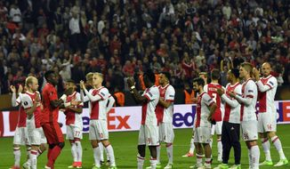 Ajax players applaud the supporters at the end of the soccer Europa League final between Ajax Amsterdam and Manchester United at the Friends Arena in Stockholm, Sweden, Wednesday, May 24, 2017. United won 2-0. (AP Photo/Martin Meissner)