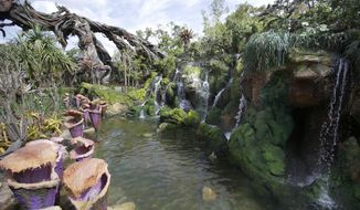 "FILE - In this April 29, 2017, file photo, landscaping consisting of real Earth plant species mixed with sculpted Pandora artificial flora is surrounded by ponds and gentle waterfalls at the Pandora-World of Avatar land attraction in Disney's Animal Kingdom theme park at Walt Disney World in Lake Buena Vista, Fla. The 12-acre land, inspired by the ""Avatar"" movie, opens in Florida at the end of May at Walt Disney World's Animal Kingdom. It cost a half-billion dollars. (AP Photo/John Raoux, File)"