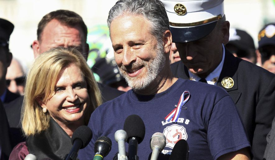 FILE - In this Sept. 16, 2015 file photo,  Jon Stewart, accompanied by Rep. Carolyn Maloney, D-N,Y., and New York City first responders speaks during a rally on Capitol Hill in Washington.  HBO says it's scrapping a Web-delivered venture it was developing with Stewart. In a statement Wednesday, May 24, 2017,  the network said the short-form digital animated project had proved too technically difficult for a quick turnaround. The animated series would have allowed Stewart to comment on daily breaking news in real time. (AP Photo/Lauren Victoria Burke)