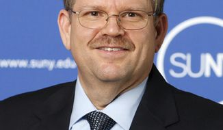 This 2014 photo provided by the State University of New York shows Alexander Cartwright, the provost and executive vice chancellor at the university. The University of Missouri System is set to hire Cartwright to run its flagship campus in Columbia, two years after the previous chancellor resigned amid protests over racial concerns on campus. The St. Louis Post-Dispatch reports that multiple sources confirmed that the Board of Curators is expected to finalize Cartwright's hiring Tuesday, May 23, 2017. (Joe Putrock/State University of New York via AP)