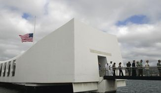 File- This Monday, Dec. 7, 2009 file photo shows the USS Arizona Memorial during the 68th anniversary ceremony of the attack on Pearl Harbor at Pearl Harbor Naval Base in Honolulu. A National Park Service employee at the USS Arizona Memorial accepted gifts from tour operators in violation of ethics regulations, U.S. Department of Interior investigators said. (AP Photo/Marco Garcia, File)