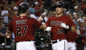 Arizona Diamondbacks' Jake Lamb (22) celebrates his two-run home run against the Chicago White Sox with Brandon Drury (27) during the fifth inning of a baseball game, Wednesday, May 24, 2017, in Phoenix. (AP Photo/Ross D. Franklin)