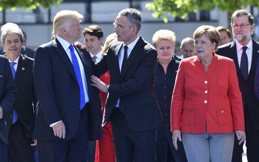 German Chancellor Angela Merkel, after hosting former President Barack Obama in Berlin, met with President Trump and NATO Secretary General Jens Stoltenberg on Thursday. (Associated Press)