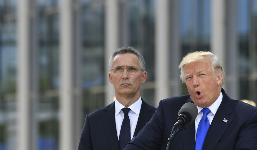 """President Trump, with NATO Secretary General Jens Stoltenberg at his side, said, """"Twenty-three of the 28 member nations are still not paying what they should be paying."""" (Associated Press)"""