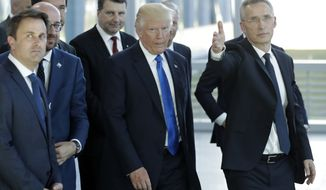 US President Donald Trump, center, speaks with NATO Secretary General Jens Stoltenberg, right, during a NATO summit of heads of state and government in Brussels on Thursday, May 25, 2017. US President Donald Trump and other NATO heads of state and government on Thursday will inaugurate the new headquarters as well as participating in an official working dinner. (AP Photo/Matt Dunham)